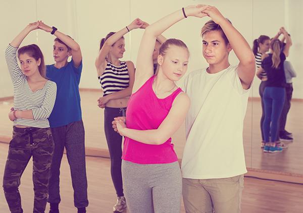Ordinary children  dancing of partner dance at dance school